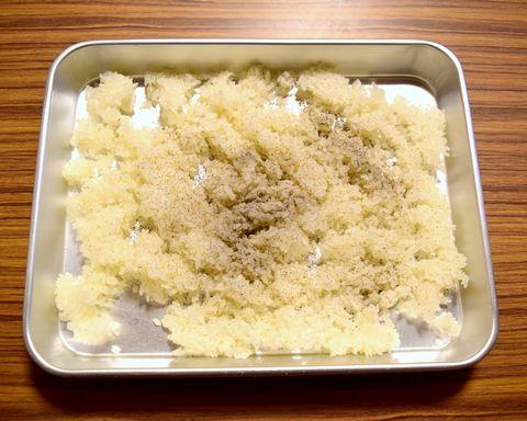 蒸した米に灰をまぶす