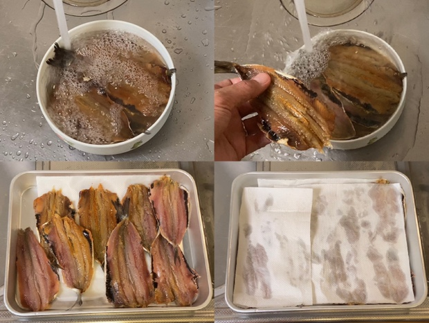 塩漬けにしたイワシを洗い水分を拭き取る
